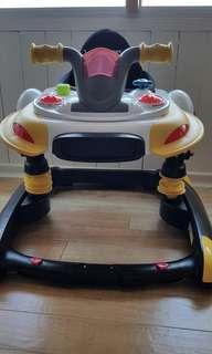 Bens baby walker and jumper. Height adjustable