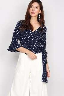 The Design Closets Willa Polkadot Wrap Top in Navy Blue