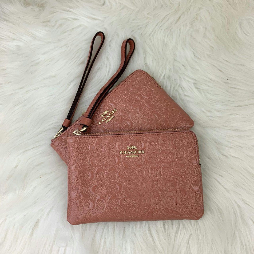 fa54d60b52f5 Coach Corner Zip Wristlet Debossed in Melon