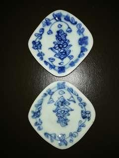 A pair of rare blue and white saucers