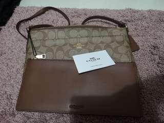 Authentic brand new coach sling bag