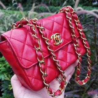Authentic True Red Lambskin Chanel Mini with 24k Gold Hardware