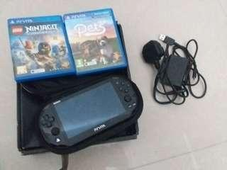 "PS Vita with case and ""Ninjago: Shadow of Ronin"" and ""Pets"" and Charger!"