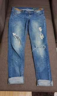 Repriced Tattered denim jeans