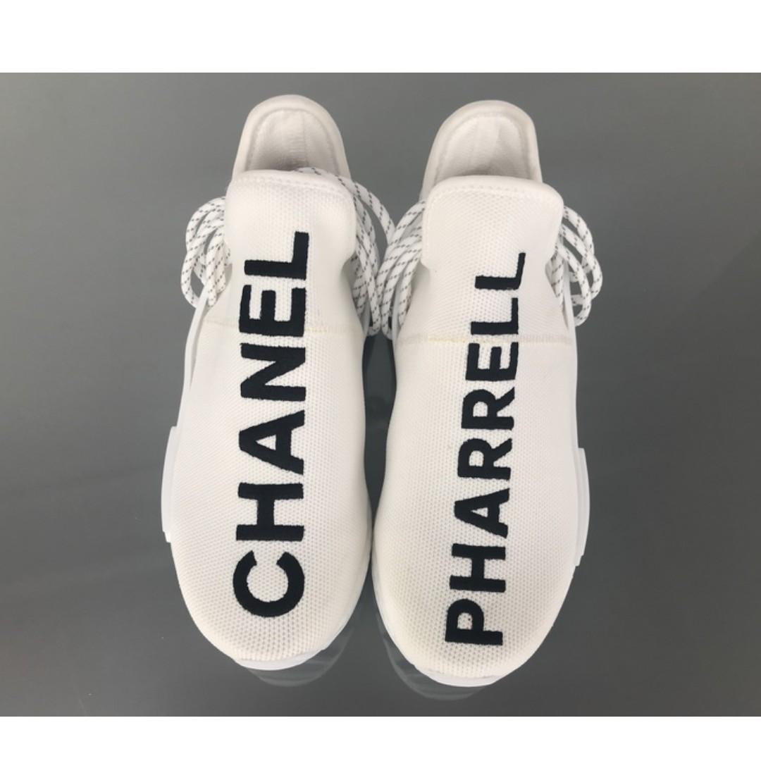 timeless design 6afe3 ffff3 Chanel X Pharrell Adidas NMD Hu