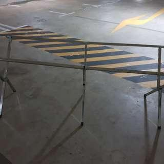 Foldable Roadshow Table With a board on top
