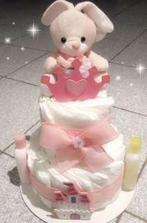 Three tier baby diaper cake makes a great baby shower gift!