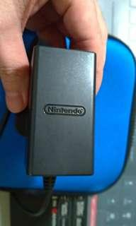 Nintendo Switch Charger with universal adapter.