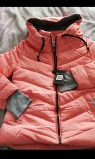 Hooded puffy pink winter jacket