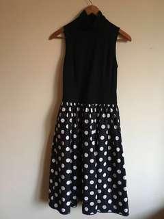 Polka dot sleeveless high neck dress