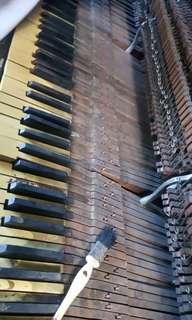 Piano service restoration and moving