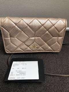 Coach wallet / clutch bag in gold