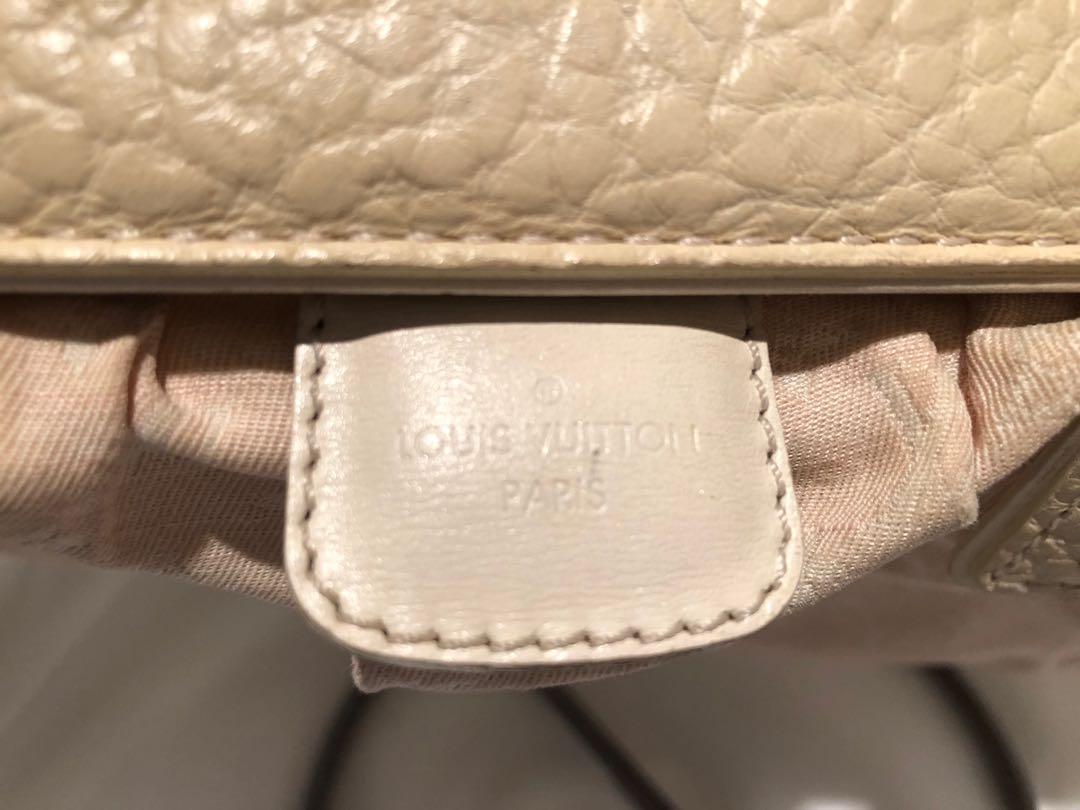 Louis Vuitton authentic minilin trapeze
