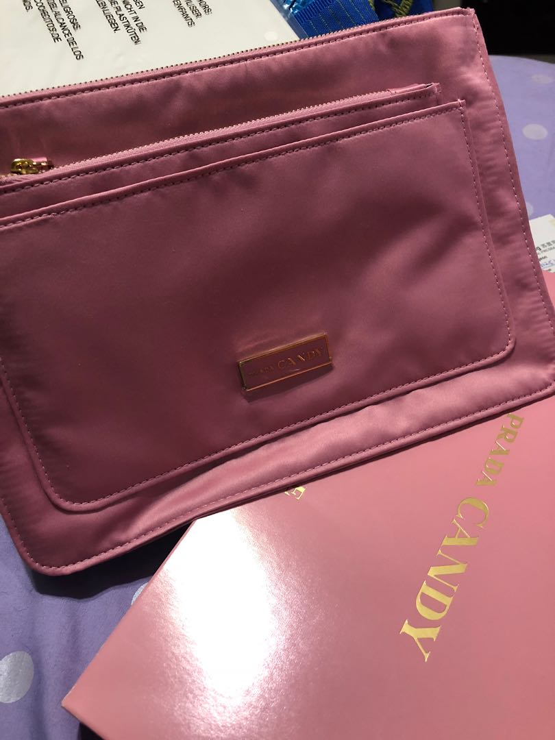 3a0e9be912ac Prada clutch, Women's Fashion, Bags & Wallets, Clutches on Carousell