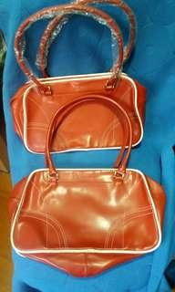 Selling 2 pcs Clarins bags (Red) Colour