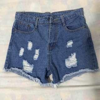 Ripped High-waist Denim Shorts.