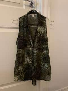 Green patterned sleeveless shirt