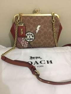 Coach kisslock keith haring authentic
