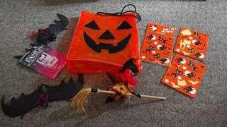Halloween trick or treat bag, pack of stickers new/sealed. 2nd pack of stickers some used. Two plastic bats which are on string can be hung up, witch on broom decoration, new kids size glow in the dark fangs.