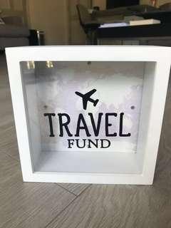Travel fund: change box