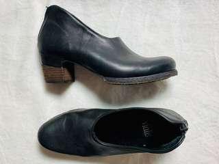 Black enclosed heel shoe