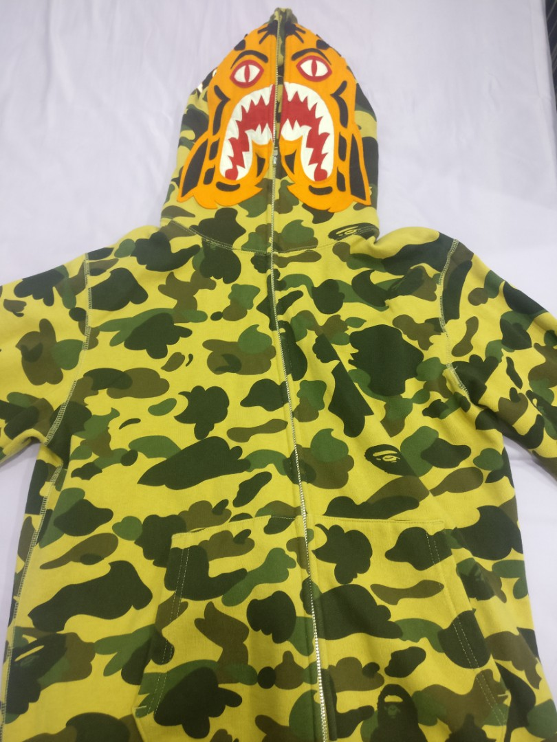3126ce619 Bape tiger camo hoodie, Men's Fashion, Clothes, Tops on Carousell