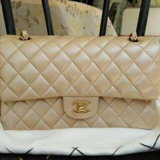 Chanel medium 2.55 double flap in Champagne color