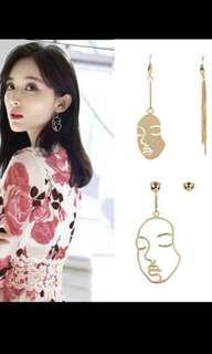Brand new Artsy face earrings