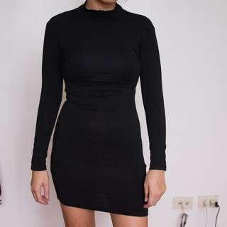 Jersey turtleneck bodycon dress with backless detail