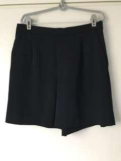 Draped dark blue shorts