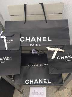 Authentic Chanel paper bags and other label louboutin, hermes, armani