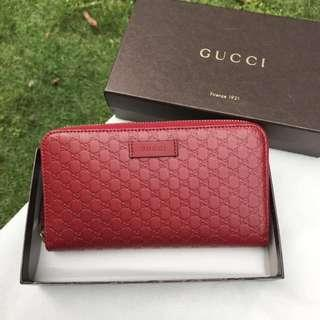 ba4d7d939de1a2 Gucci Micro Guccissima Signature Zip Around Leather Wallet in Red