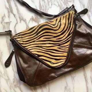 Pony with cow leather shoulder bag beige zebra pattern