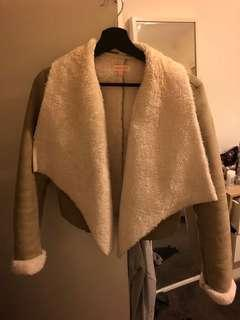 Cropped tan jacket with white shearling fur