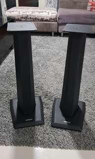 A pair of metal speaker stands