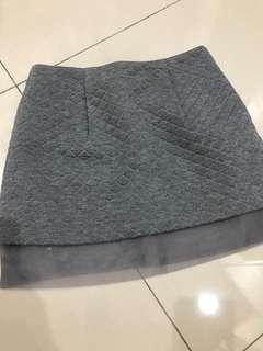Grey skirt with designed lining