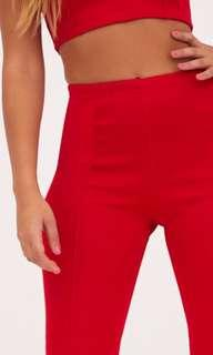 Red high waisted extreme flare long trousers