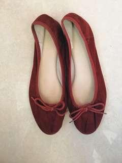 Flat red doll shoes