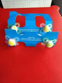 4 Brand new silicone pacifiers,  0 to 6 months plus.