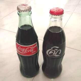 2 x vintage Coca Cola glass bottles - one from Japan one from Thailand