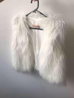 Fluffy white vest