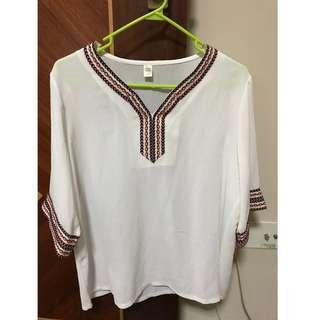 Three quarter sleeves top with embroidery