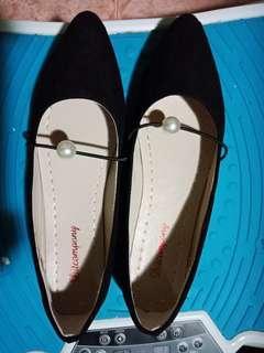 Female black flat shoes