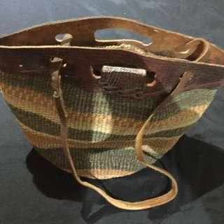 Woven and leather purse