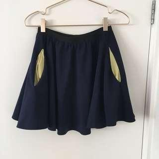 Blue skirt with yellow pockets