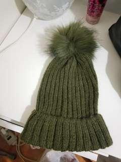 Olive green pom pom hat