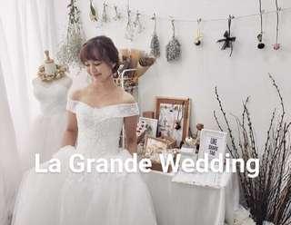 Off shoulder white wedding gown