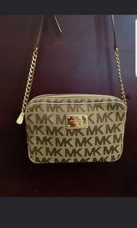 Repost orig MK sling bag