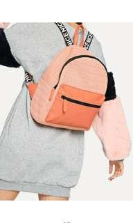 Peach orange colour mini backpack with letter strap