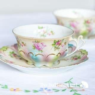 Stunning rainbow coloured antique porcelain cup and saucer, pastel pink, green and blue